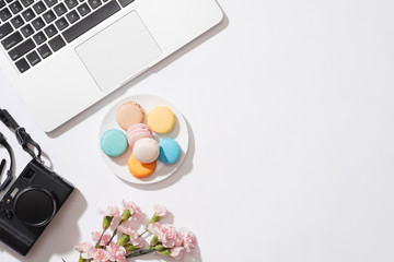 Cozy morning breakfast with pastel colorful macarons or macaroons.