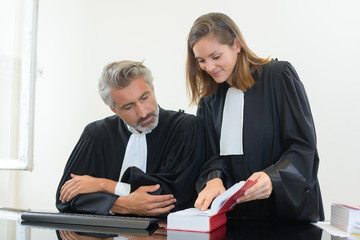 two judges looking at the law book