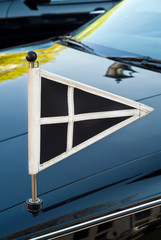 Official flag on a Dutch funeral car