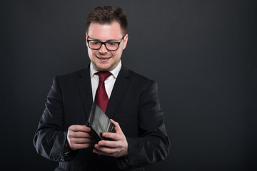 Portrait of business man looking in his wallet.