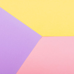 Texture background of fashion pastel colors: pink, yellow and purple geometric pattern papers. minimal abstract