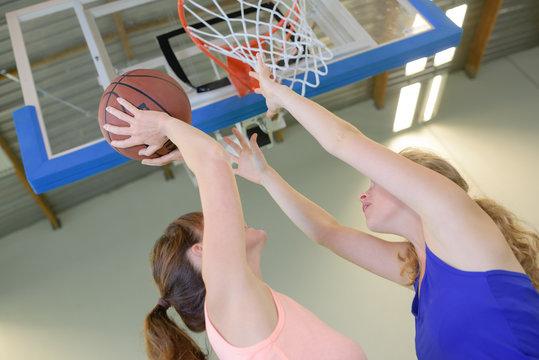 Woman aiming for netball goal