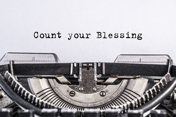 Count your Blessing, text on paper typed on Vintage old typewriter. close-up, retro
