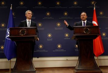 NATO Secretary-General Jens Stoltenberg and Turkish Foreign Minister Mevlut Cavusoglu attend a news conference in Ankara