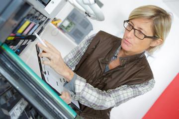 woman on printer maintenance