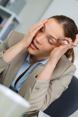 business woman suffering from headache
