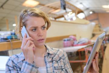 concerned designer talking phone in office