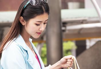 Beautiful Asian Women happy and walking shopping in the city.