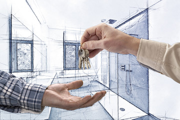 Realtor giving house key to buyer in empty tiled bathroom