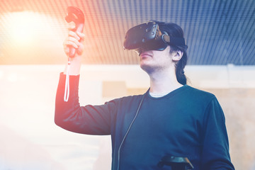 Man with virtual reality glasses playing video game