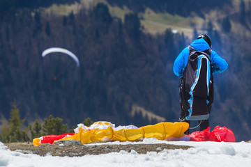 paraglider preparing to start in the mountains