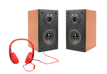 Music and sound - Two black loudspeaker enclosure and red headphone. Isolated