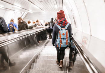 People stand on the escalator in the metro or subway, the concept of public urban underground transport