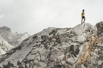 Ultra trail runner looking to horizon in Picos de Europa Natural Park, Asturias, Spain