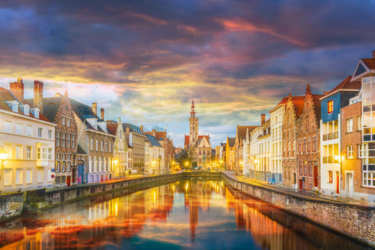 Spiegelrei canal and Jan Van Eyck Square at sunset time, Belgium