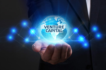 Business, Technology, Internet and network concept. Young businessman working on a virtual screen of the future and sees the inscription: Venture capital