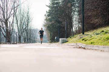 young man running outdoor training in the city - exercise, healthy lifestyle, sport concept