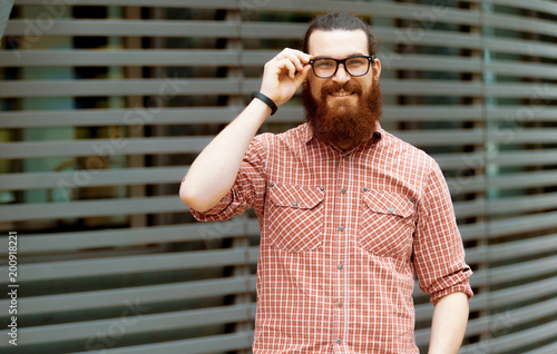 a83ff7bf5 young guy with a beard and mustache with glasses posing on the street,  fashion man, style, vintage style, retro men, handsome beard, outdoor  portrait, ...