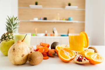 Organic fruits and vegetables on the table at the kitchen. Raw nutrition