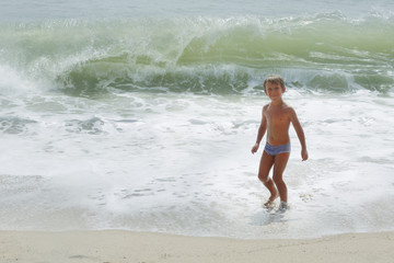 Happy child playing in sea