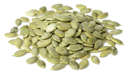 raw pumpkin seeds isolated on white