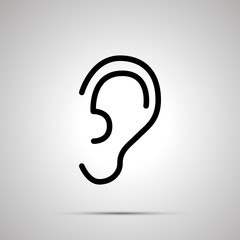 Simple black human ear icon with with shadow