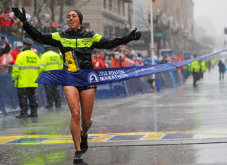 Desiree Linden of the U.S. crosses the finish line to win the women's division of the 122nd Boston Marathon in Boston