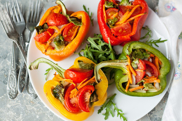 Baked bell peppers stuffed with vegetables