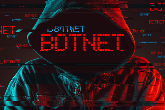Botnet concept with faceless hooded male person