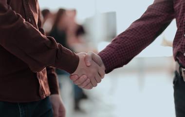 closeup of handshake between two men i