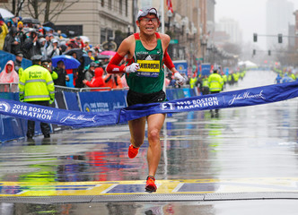Yuki Kawauchi of Japan crosses the finish line to win the men's division of the 122nd Boston Marathon in Boston