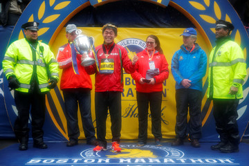 Yuki Kawauchi of Japan celebrates with the trophy after winning the men's division of the 122nd Boston Marathon in Boston