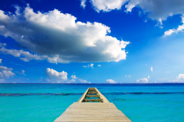 Perspective view of a wooden pier on the caribbean sea.