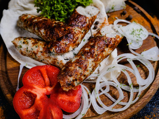 shish kebab. Charred meat and fresh onions and peppers. Traditional Georgian food. Delicious restaurant meal