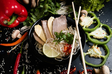 thai cuisine. healthy balanced nutrition. wholesome food diet. noodle meat soup and vegetable meal.
