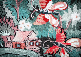 Needlework, a fragment of woven panels depicting a house and butterflies.