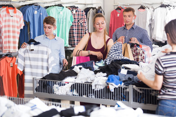 People choosing clothes a half-off sale
