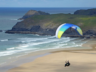 Paraglider above Perranporth Beach