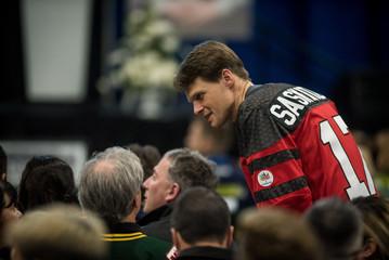 Saskatoon Mayor Clark speaks with attendees at a memorial celebration for Evan Thomas in Humboldt