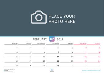 Wall calendar for February 2019. Vector design print template with place for photo. Week starts on Monday. Landscape orientation