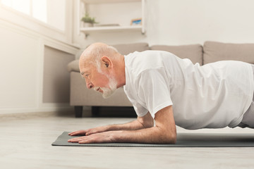 Senior man fitness workout, push ups or plank