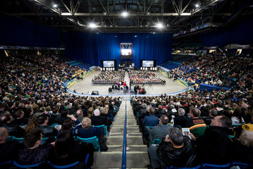 People attend a memorial celebration for Evan Thomas, one of the players killed in the bus crash carrying the Humboldt Broncos Junior A hockey team