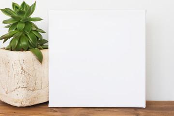 Mockup poster. White square canvas in interior.