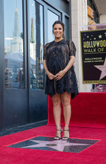 Eva Longoria poses on the Hollywood Walk of Fame in Los Angeles