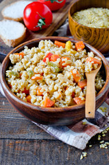 Porridge from bulgur with vegetables: carrots, bell peppers, onions, zucchini