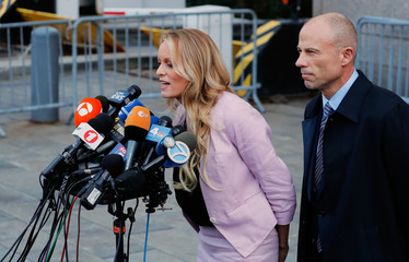 Adult film actress Stephanie Clifford, also known as Stormy Daniels speaks to media along with lawyer Michael Avenatti  outside federal court in Manhattan