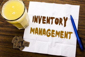 Handwriting Announcement text showing Inventory Management. Business concept for Stock Supply written on tissue paper on the wooden background with pen and healthy juice in the restaurant