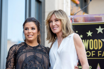 Eva Longoria and Felicity Huffman pose on the Hollywood Walk of Fame in Los Angeles