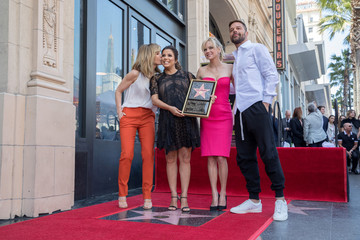 Felicity Huffman, Eva Longoria, Anna Faris and Ricky Martin pose on the Hollywood Walk of Fame in Los Angeles