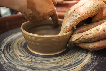 hand maid, molding from clay, making dishes.